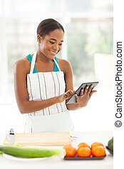 young afro american woman searching for a recipe