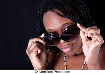 young afro-american woman with white sunglasses against black background
