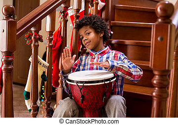 Friendly afro child with drum.