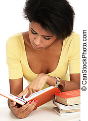 Young afro woman studying with books