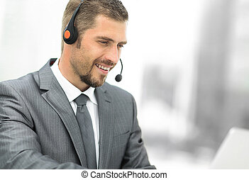 young agent of the call center with the headphones. - photo...