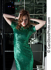 Young aggressive woman in green fashion dress