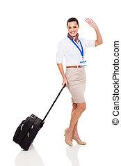 young air hostess waving goodbye