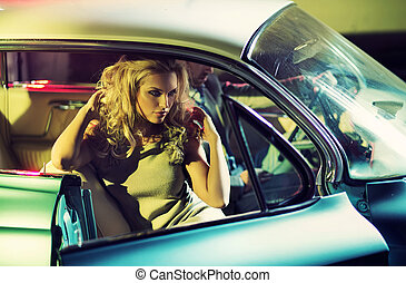 Young alluring couple in the retro car