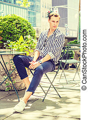 Young American Man relaxing outside in New York City,
