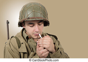 young American soldier smoke cigarette, world war two -...