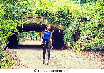 Young American Woman traveling at Central Park, New York