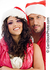 young amorous couple wearing christmas hat