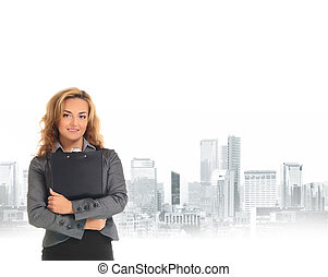 Young and attractive business woman over city background