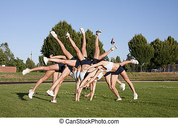 Young and Attractive Female Athlete does cartwheels