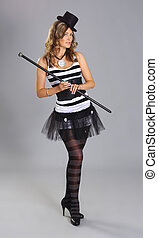 Young and attractive female circus artist over grey ...
