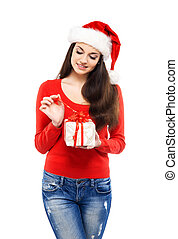 Young and attractive teenager girl with a Christmas present isol