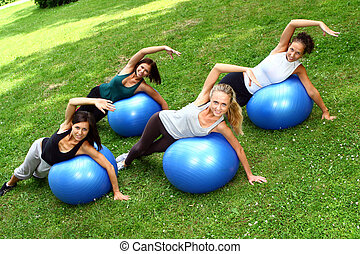 Young and attractive womans doing fitness exercises