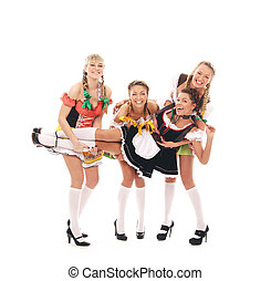 Young and beautiful bavarian girls isolated over white...
