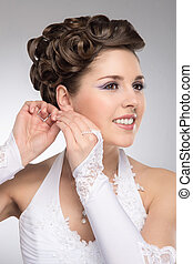 Young and beautiful bride preparing for the wedding