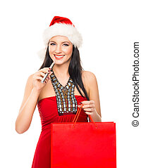 Young and beautiful Christmas shopper girl with the...