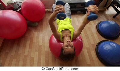 Young and beautiful girl Coaches chest muscles in the room fitness club.