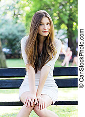 Young and beautiful girl in park