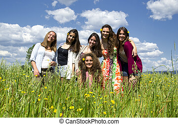 Young and beautiful girls on a field.
