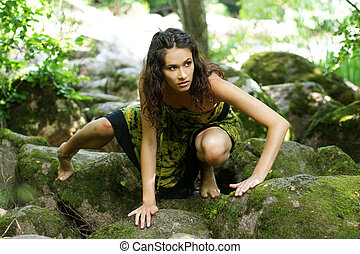 Young and beautiful savage girl in jungle