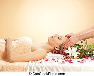 Young and beautiful woman getting spa treatment