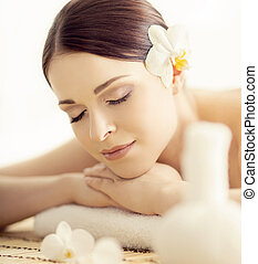 Young and beautiful woman in spa. Massaging and healing concept.
