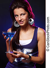 Young and beautiful woman in the nightclub