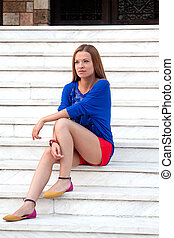 woman sitting on the steps of