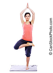 Young and beutiful girl doing yoga exercises