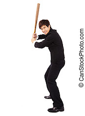 Young and confident businessman holding a baseball bat preparing to strike