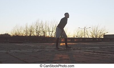 Young and fit man having evening workout outdoor. Urban ...