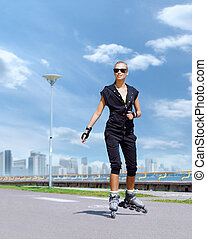 Young and fit woman rollerblading on skates - Young,...