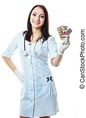 Young and friendly woman doctor holding offering pills isolated on white background