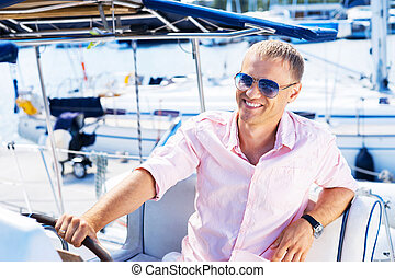 Young and handsome man on a boat - Young and handsome man on...