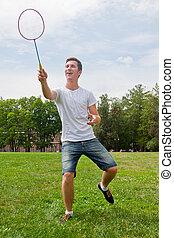 man playing badminton