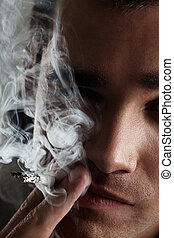 Young and handsome man smoking