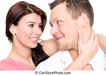 Young and happy couple in front of white background