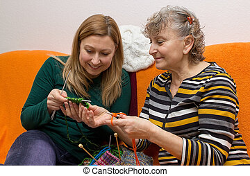 Young and old while knitting - Young and old knitting and...