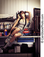 Young and sexy woman in garage