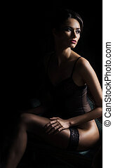 Young and sexy woman relaxing in erotic lingerie - Sensual...