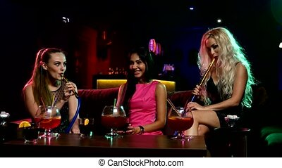 young and sexy woman smoking hookah - Group of young and...