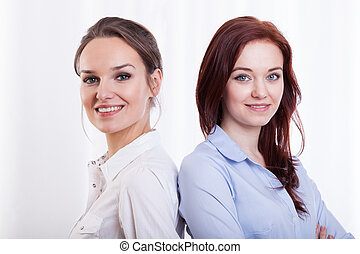 Young and smiling female friends