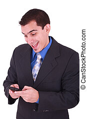 young and smiling man looking at his cellphone