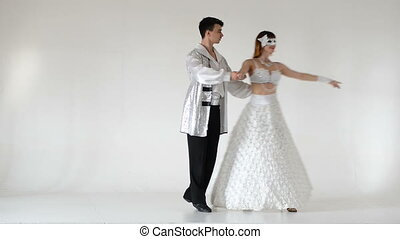 young and stylish ballet couple dancing on white background