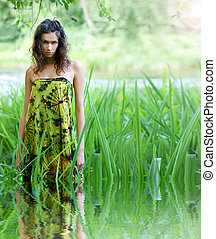Young and wild woman in jungle