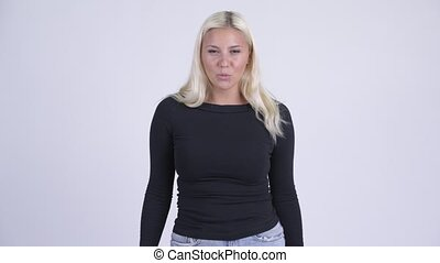 Young angry blonde woman talking and complaining