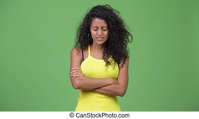 Young angry Hispanic woman with arms crossed - Studio shot...