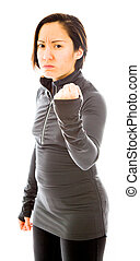 Young angry woman with fist up isolated on white background