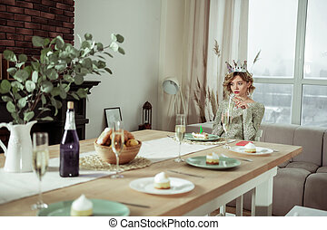 Young appealing woman feeling lonely on her birthday at home