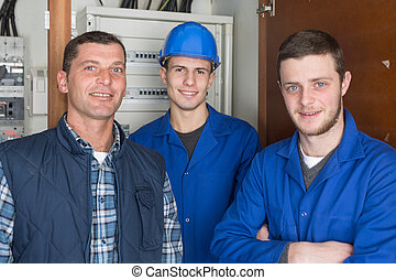 young apprentices with electrician professional